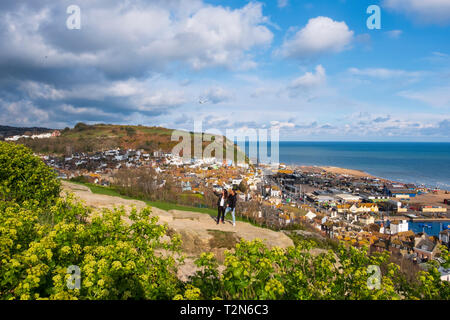 Hastings, East Sussex, UK. A couple take a selfie in the late afternoon sun, of the picturesque view from West Hill, overlooking the Old Town harbour - Stock Image