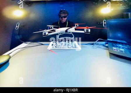 Using Magic Leap One mixed reality goggle for Mimesys debut of holographic collaboration as 2 people build drone at Intel booth at CES, Las Vegas, USA - Stock Image