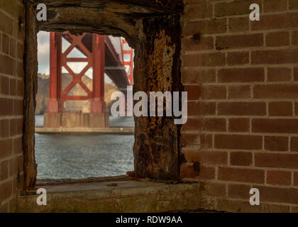 A view of part of the Golden Gate Bridge in the morning viewed from a window at Fort Point in San Francisco - Stock Image