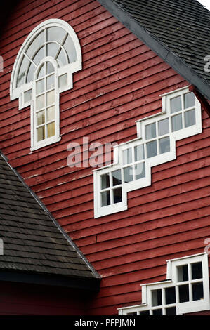 Chile, Los Lagos Region, Frutillar city, traditional house of German architecture with multi-lit windows - Stock Image