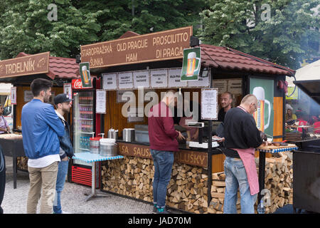 Customers queuing at a beer and sausage stand in Wenceslas Square, Prague Old Town, Czech Republic - Stock Image
