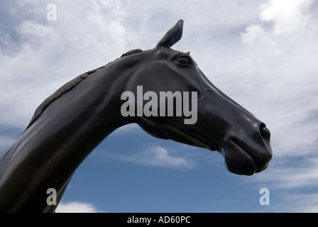 Bronze statue of ten year old racehorse Best Mate winner of three Gold Cups at the Cheltenham Races National - Stock Image