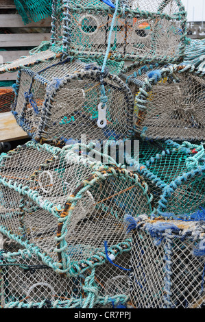 Lobster and crab pots (creels) by the harbour of the Fife fishing port of Pittenweem - Stock Image