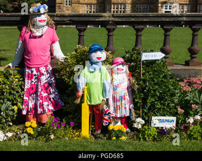 Marske North Yorkshire August 25th/ Like many Yorkshire villages Marske by the Sea has a weeklong Scarecrow Festival which started today 25th August,  many different organisations and social groups have made scarecrows an erected them around the village.  Parents and children can get a trail map to follow and view all the exhibits.  There is a prize draw at the end of the week.  Mothers Union Display of a mother anD children going to the beach Credit: Peter Jordan_NE/Alamy Live News - Stock Image