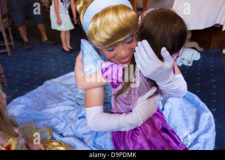 4 year old girl meeting Cinderella at Auberge de Cendrillon, Disneyland Paris - Stock Image