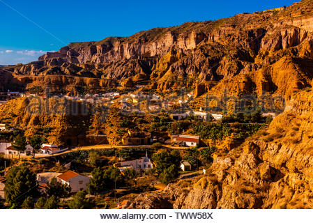 Rock formations, the town of Gorafe and the surrounding Gorafe Desert, Granada Province, Andalusia, Spain. - Stock Image