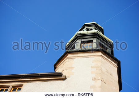 Poznan, Poland - February 6, 2019: Top of the Adam Mickiewicz university building and a blue sky. - Stock Image