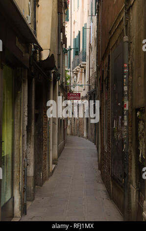 A narrow Street in Venice Italy - Stock Image