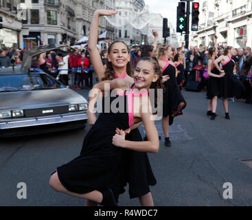 The elite song and dance troop 'The West End Kids', performing to  tunes from the 'Back to he Future Films, in front of the DeLorean Time Machine - Stock Image