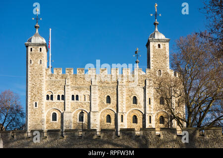 The famous London landmark the White Tower, part of the Tower of London with blue skies - Stock Image