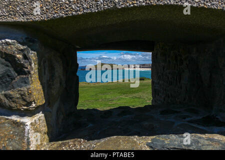 Looking towards Porthmeor beach through a rock window, St. Ives, Cornwall, England, UK - Stock Image