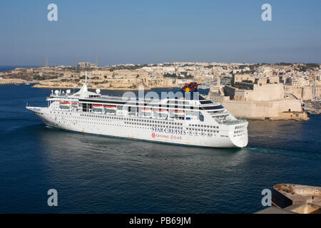 The cruise ship or liner SuperStar Libra departing from Malta's Grand Harbour - Stock Image