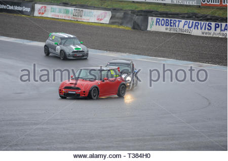 Dunfermline, Scotland, UK. 7th April, 2019.    during a Scottish Fiesta/Mini Cooper S Cup  race at Knockhill Circuit. During a wet and misty opening round of the Scottish Championship Car Racing season organised by the SMRC (Scottish Motor Racing Club) at Knockhill. Credit: Roger Gaisford/Alamy Live News - Stock Image