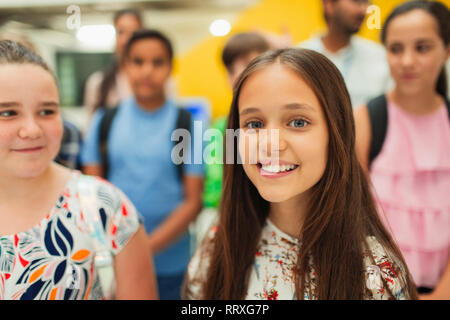 Portrait confident, smiling junior high girl student - Stock Image