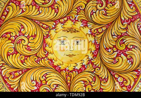 TAORMINA, ITALY - APRIL 9, 2018: The Sun - detail of Sicilian ceramic. - Stock Image