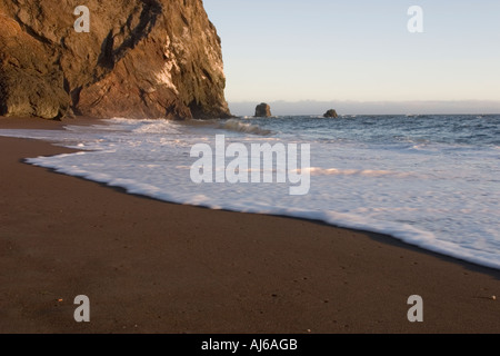 Foamy surf at Tennessee Beach in Tennessee Valley Marin Headlands Golden Gate National Recreation Area California USA - Stock Image