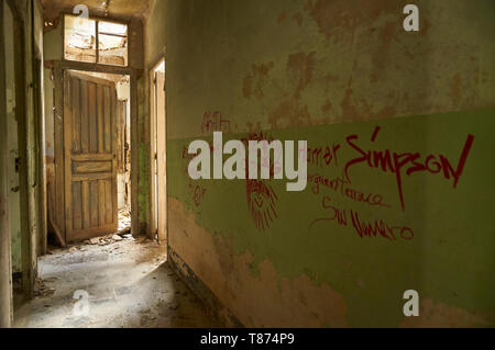 Interior of ruined facilities covered by graffiti at the Canfranc International railway station (Canfranc, Pyrenees, Huesca, Aragon, Spain) - Stock Image
