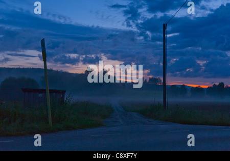 T-junction at midnight in Varmland, Sweden. - Stock Image