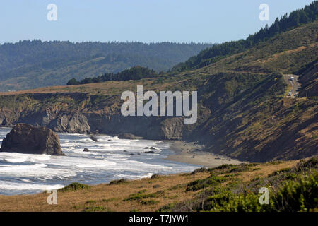 The scenic coast of northern California, along Highway 101 showing the road that hugs the cliffs along the ocean on a summer day - Stock Image