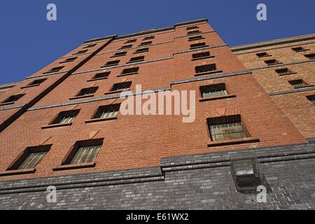 One of several old customs warehouses in the city of Bristol old dock area ,viewed upwards showing a blue sky above. - Stock Image