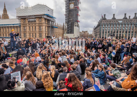 Westminster Bridge, London, UK. 15th Mar 2019. Extinction Rebellion organise a Youth After Party which blocks Westminster Bridge. The followed and was attended by School students who were striking over the lack of action on climate change. Credit: Guy Bell/Alamy Live News - Stock Image