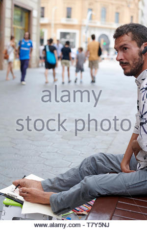 Artist who uses his feet on the  Street in the City of Barcelona in Catalunya in Spain in Europe - Stock Image