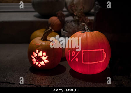 Low Battery Life Pumkin Carved at Halloween - Stock Image