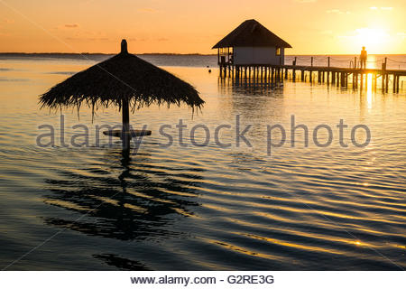 Sunset over the lagoon in French Polynesia - Stock Image