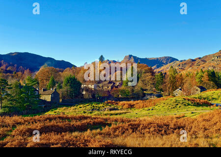 A sunny autumn view of Elterwater Village in the Langdale Valley in the English Lake District. - Stock Image