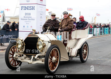 A 1903, White Mercedes crosses the finishing line during the 2018 London to Brighton Veteran Car Run - Stock Image