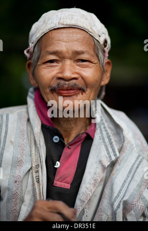 A Hanunoo Mangyan man with red-stained mouth, the telltale sign of chewing betel, or nga nga, in Oriental Mindoro, Philippines. - Stock Image