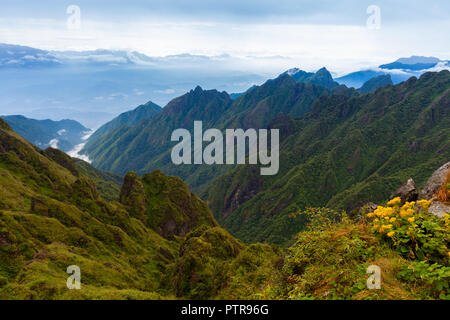 Stunning view of the mountainous terrain from the summit of the highest Indochina peak, the Fansipan Mountain, Sapa, Lao Cai, Vietnam - Stock Image
