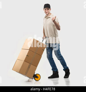 Courier - a handcart packages - Stock Image