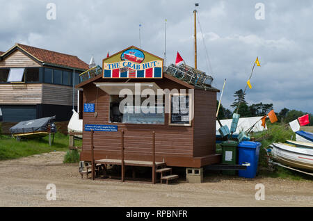 The Crab Hut on the quayside at Brancaster Staithe, Norfolk, UK; selling baguettes filled with fresh seafood caught locally by Simon Letzer. - Stock Image
