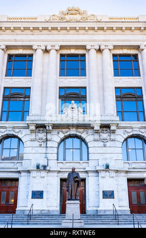 Panoramic image of Louisiana Supreme Court building with statue of Edward Douglas White in foreground, Royal St, New Orleans French Quarter, New Orlea - Stock Image