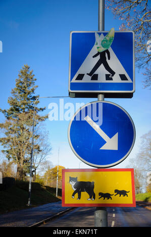 Unusual cat road signs outside the home of the children's book character Peter-No-Tail, Uppsala, Sweden. - Stock Image