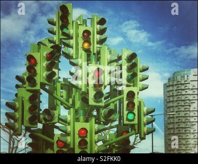 """A retro effect image of """"The Traffic Light Tree"""" on Trafalgar Way, Canary Wharf area, London, England. A artistic sculpture, not intended to control the flow of traffic. Stop or Go??! © COLIN HOSKINS. - Stock Image"""