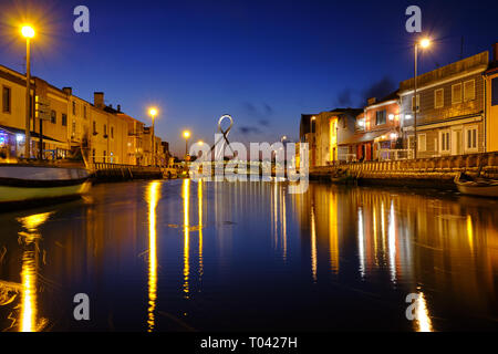 Canal in Aveiro with circular pedestrian bridge background during blue hour. Long exposure. In Aveiro Portugal, June 22, 2017 - Stock Image
