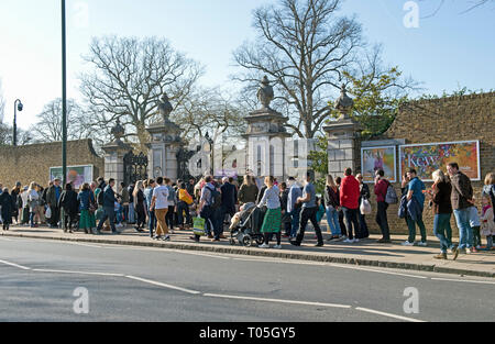 People queuing to enter Kew Gardens at the Victoria Gate on a sunny day in February. - Stock Image