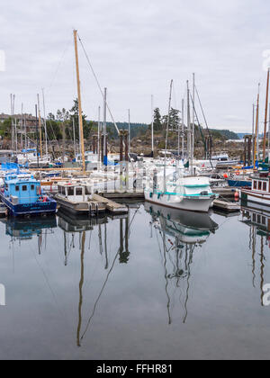 Small boats moored at Ganges Harbour marina, Salt Spring Island, BC, Canada. - Stock Image