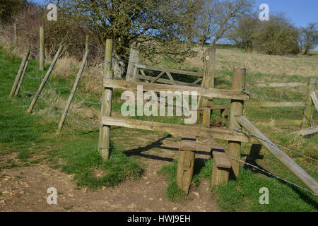 Wooden stile on footpath near the Cotswold village of Swinbrook near to Burford, Oxfordshire - Stock Image