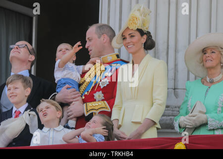 London, UK. 08th June, 2019. One year old Prince Louis steals the show on his debut public engagement.Appearing on the Buckingham Palace balcony, to watch the fly-past with his parents, TRH The Duke and Duchess of Cambridge, and his siblings, Prince George and Princess Charlotte. Trooping the Colour, The Queen's Birthday Parade, London, UK Credit: amanda rose/Alamy Live News Credit: amanda rose/Alamy Live News - Stock Image