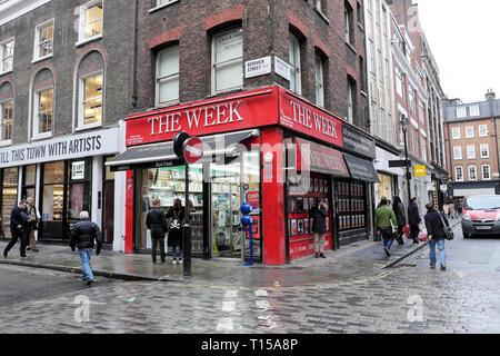 The Week newsagent shop on the corner of Berwick street on a rainy day  in Soho London UK  KATHY DEWITT - Stock Image