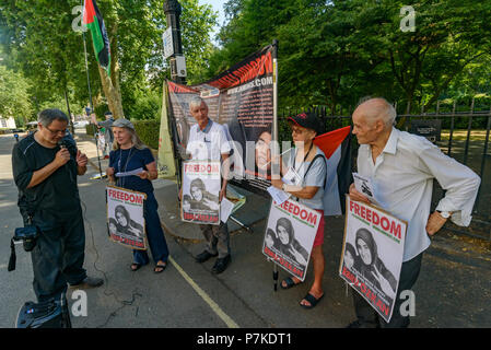 London, UK. 6th July 2018. Inminds human rights group hold a vigil outside the Turkish Embassy in London to urge the Turkish government to put pressure on Israel to release 27 years old Turkish national Ebru Ozkan. She was arrested when boarding a flight home on 11th June from Tel Aviv after a 4 day holiday group tour, and has now been held without charge for 24 days accused of 'threatening Israel's security and having links with terrorist groups.' Credit: Peter Marshall/Alamy Live News - Stock Image