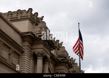 US flag outside US Stock Exchange on Wall Street. - Stock Image