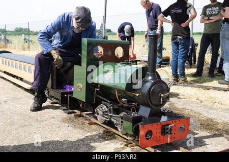 Stoking miniature steam engine at Wings and Wheels - Stock Image