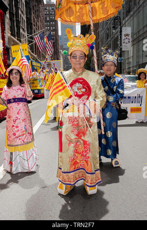 Portrait of an older man in traditional ethnic clothing & shoes at the Vietnamese American Cultural Parade in Midtown Manhattan, New York City. - Stock Image