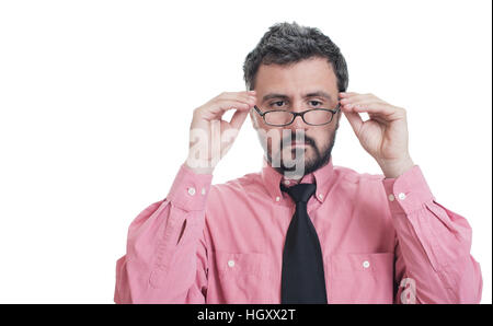 Man taking an eye exam and wearing glasses - Stock Image