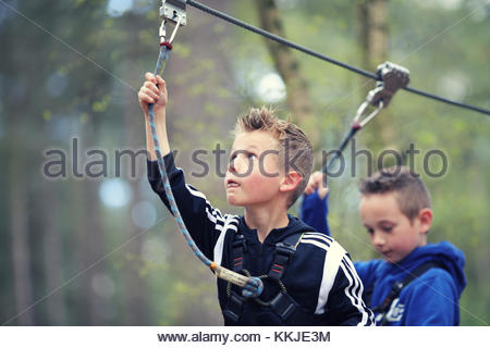 kids on zip wire - Stock Image