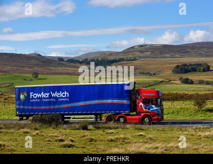 Fowler Welch Listening...Responding...Delivering HGV. JHP Transport Lanark. M6 Northbound carriageway, Shap, Cumbria, England, United Kingdom, Europe. - Stock Image